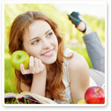Woman Relaxing While Holding an Apple